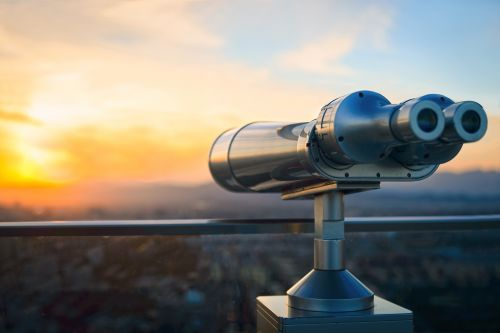 Invest with Long-Term perspective - binoculars looking at sunset